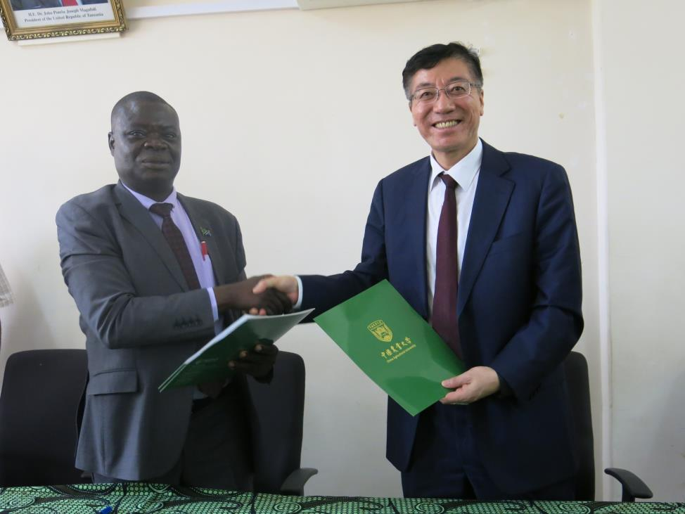 Sokoine University of Agriculture (SUA) Vice Chancellor Prof. Raphael Chibunda (Second left) and the President of China Agricultural University Prof. SUN QIXIN signing partnership agreement between the two universities