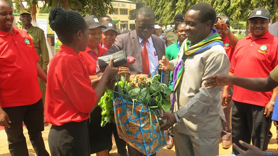 Tanzania Minister for Industries, Trade and Investiment Hon. Charles Mwijage (right) visiting Sokoine University of Agriculture at Nane Nane 2018 together with vice Chancellor Prof. Raphael Chibunda