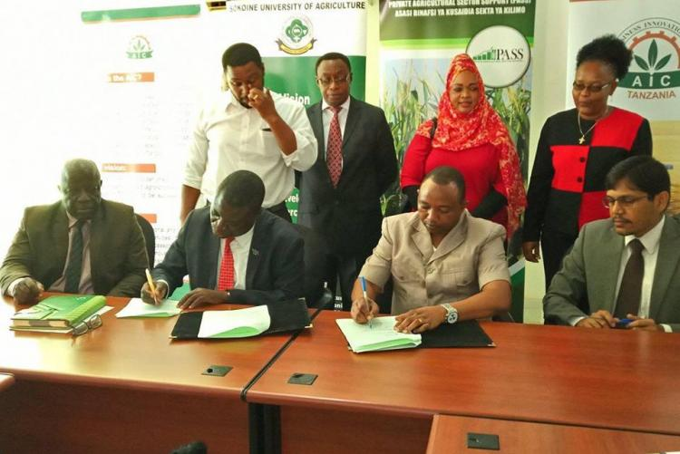 Vice Chancellor of Sokoine University of Agriculture Prof.Raphael T. Chibunda (Left) and PASS Dorector Mr. Nicomed Bohay (Right) signing the partnership agreement between the two institutions at Sokoine University of Agriculture